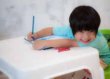 Smiling Boy Drawing and Painting Stock Image