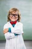 Smiling boy dressed as scientist standing in classroom. Portrait of smiling boy dressed as scientist standing in classroom Royalty Free Stock Image