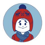 Smiling boy dressed in red knitted hat with deers Royalty Free Stock Images