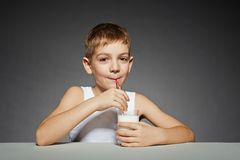 Smiling boy drinking  milk Royalty Free Stock Images