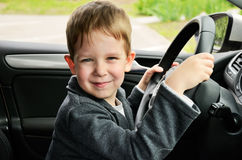 Smiling boy driving horizontal Royalty Free Stock Photography