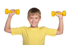 Smiling boy with dumbbells do exercises Stock Photography