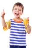 Smiling boy enjoying with glass of juice Stock Photo