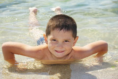 Smiling boy enjoying sea bathing Stock Images