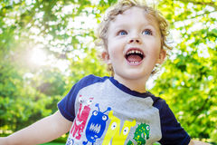 Smiling boy enjoying a walk in park Royalty Free Stock Images
