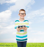 Smiling boy in eyeglasses holding spectacles Royalty Free Stock Photography