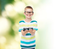 Smiling boy in eyeglasses holding spectacles Stock Images