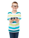 Smiling boy in eyeglasses holding spectacles Royalty Free Stock Photos