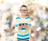Smiling boy in eyeglasses holding spectacles Royalty Free Stock Images