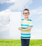 Smiling boy in eyeglasses with white blank board. Vision, health, advertisement, nature and people concept - smiling little boy wearing eyeglasses with white royalty free stock image