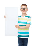 Smiling boy in eyeglasses with white blank board. Vision, health, advertisement and people concept - smiling little boy wearing eyeglasses with white blank board royalty free stock photos