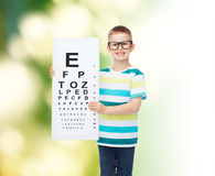 Smiling boy in eyeglasses with white blank board. Vision, health, ecology, ophthalmology and people concept - smiling little boy wearing eyeglasses with white royalty free stock photography