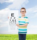 Smiling boy in eyeglasses with white blank board Stock Photos