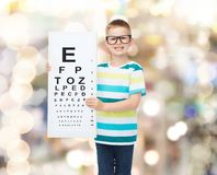 Smiling boy in eyeglasses with white blank board Stock Image