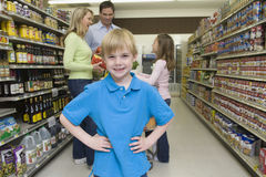 Smiling Boy With Family Shopping In Supermarket Royalty Free Stock Images