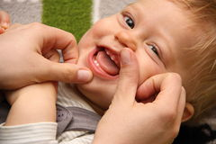 Smiling boy with first deciduous teeth. Smiling toddler with first deciduous teeth royalty free stock image
