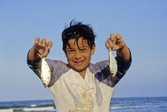 Boy with fishes Stock Image