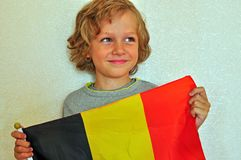 Smiling boy with a flag Stock Photography