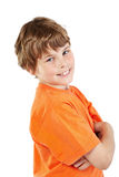 Smiling boy with folded arms stands half-turned Stock Images