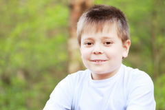 Smiling boy in forest Royalty Free Stock Image