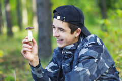 Smiling Boy in the forest with mushroom Stock Image