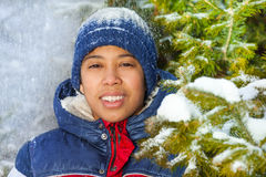 Smiling boy in the forest with snow flakes Stock Photo