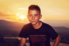 Smiling boy in front of sunset Royalty Free Stock Photography