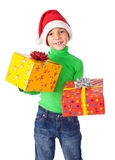 Smiling boy with gift boxes Stock Photography