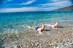 Smiling boy and girl on the beach, swim in the sea. Two miling boy and girl on the beach, swim in the sea Royalty Free Stock Photography