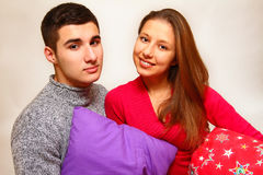 Smiling boy and girl with Christmas pillows  on white ba Royalty Free Stock Photography