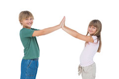 Smiling boy and girl high fiving Stock Photo