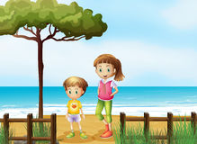A smiling boy and a girl. Illustration of a smiling boy and a girl standing on a beach Stock Photography