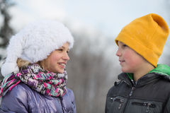 A smiling boy with a girl look at each other Stock Photography