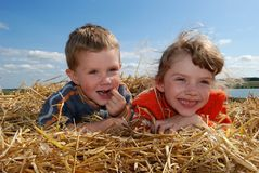Smiling boy and girl outdoors Stock Photos