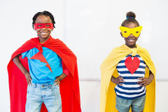 Smiling boy and girl pretending to be a superhero Stock Images
