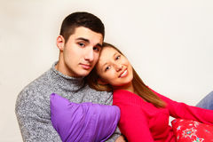 Smiling boy and girl sitting with Christmas pillows  Royalty Free Stock Photo