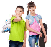 Smiling boy and girl with skate and rollers. Isolated on white background stock photography