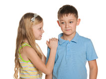Smiling  boy and  girl are standing together Royalty Free Stock Photography