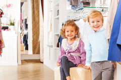 Smiling boy and girl are together while shopping Stock Photos