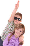 Smiling boy and girl on a white background Royalty Free Stock Photo