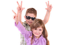 Smiling boy and girl on a white background Stock Photos