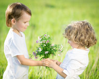Smiling boy giving bouquet Stock Images