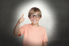 Smiling boy with glasses saying Ok Royalty Free Stock Photo