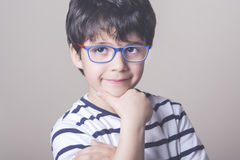 Smiling boy with glasses. And striped shirt Stock Photo
