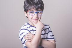 Smiling boy with glasses. And striped shirt Stock Image