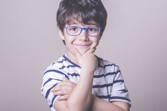 Smiling boy with glasses. And striped shirt Royalty Free Stock Photography