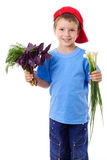 Smiling boy with greens Stock Photography