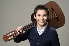 Smiling boy with guitar. Teenager boy with classic wooden acoustic  guitar Royalty Free Stock Image