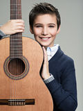 Smiling boy with guitar. Stock Photography