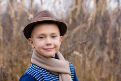 Smiling boy in a hat Stock Images